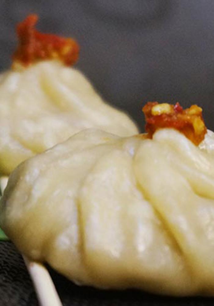 Vegetarian Szechuan Momos with Mushroom Filling